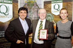 Butcher George Payne, centre, with his Smithfield Awards best English lamb trophy, joined by celebrity chef Jean-Christophe Novelli and Laura Bishop, market manager of award sponsors EBLEX.